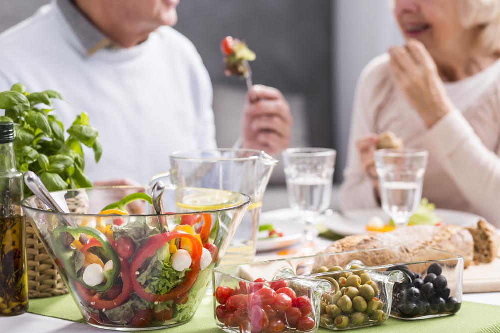 Senior couple eating healthy dinner